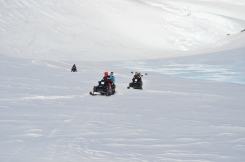 The team trade;ling on snow mobiles to the wind scoop by Vesleskarvet