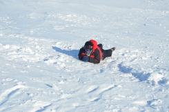 Tebogo using an ice axe to arrest her slide down a slope