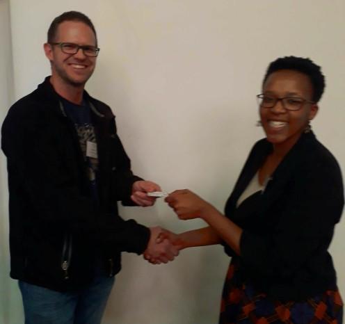 Jay le Roux awarding the prize for best student presentation to Namso Nyamela.