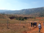 Workshop attendees walking down to the erosion site (gully).